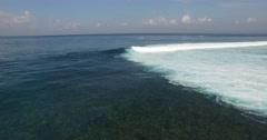 AERIAL overhead shot waves breaking at shipwrecks surf break in BALI Stock Footage