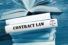 Book with Contract Law word on table in a courtroom or enforcement office. Toned - stock photo