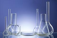 Assorted empty laboratory glassware, test-tubes. Blue tone medical background - stock photo