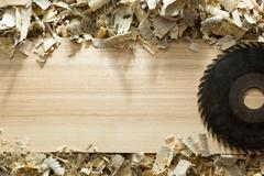 Carpenter tools on wooden table with sawdust Stock Photos