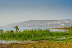 Israel Lake Tiberias with part of the city of Tiberias in the background Stock Photos