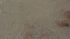 Feet in seawater Stock Footage