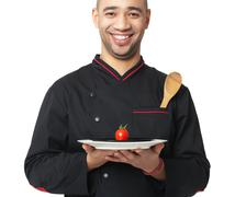 Afro American professional cook holding plate - isolated on white. - stock photo