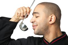 Portrait of Afro American professional cook with soup ladle - isolated. Stock Photos
