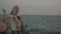 She throws a stone in the sea Stock Footage