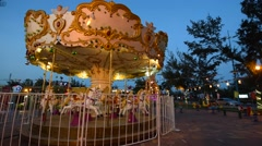 Pony rides on a merry-go-round carousel Stock Footage