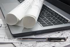 Workplace of architect - Architectural project, blueprints, rolls and tablet Stock Photos