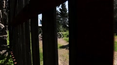 Six bicycles in front of road and open gates in countryside. Summer sunny day Stock Footage