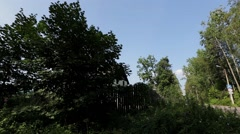 View of countryside with green trees and mansion. Summer. Pan horizontal. Nobody Stock Footage