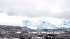Tabular iceberg field, rough seas, Antarctica Stock Footage