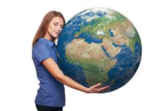 Woman holding earth globe - stock photo