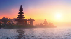 Bali temple silhouette and sunset sunshine over holy site in Indonesia Stock Footage