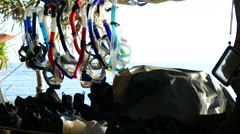 Snorkeling gear hanging at the beach - stock footage