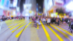 Seamless looping video with blur effect of anonymous people cross night street Stock Footage