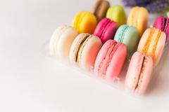 Box of french sweet delicacy macaroons isolated - stock photo