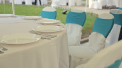 Table setting with eating utensils on a gorgeous banquet - stock footage
