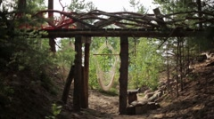 Hammock suspend on wooden bridge. Summer forest. Without people - stock footage