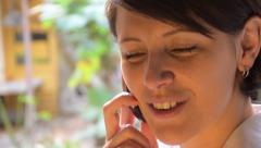 Pretty brunette woman talking on phone Stock Footage