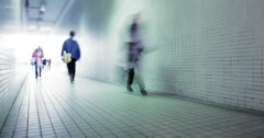 People walk through long tunnel with bright light at the end. City rush concept Stock Footage