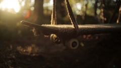 Swing made from skateboard shake on wind in summer forest. Nobody Stock Footage