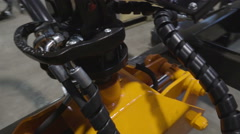 Upside view of the yellow log grapple Stock Footage