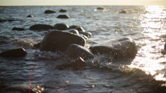 Waves crashing on the rocks on sea coast under sunshine. Nobody. Slow motion Stock Footage