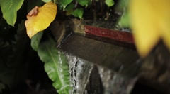 Water pours into big cask. Small fountain. Day. Realx, meditation - stock footage