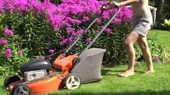 Female barefoot cut meadow lawn mower in park with flower. 4K Stock Footage