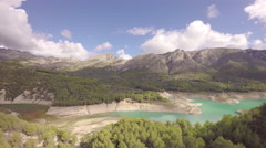 Aerial view of reservoir and dam at Guadalest and mountains - Spain Stock Footage