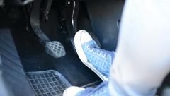 Man drives a car - detail of pedals car (legs) Stock Footage