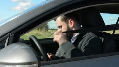Young handsome hipster man sits in the car and straps in- countryside  Stock Footage