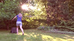 Lawn mow evening sunlight Stock Footage