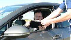 Young handsome hipster man sits in the new car and signs a contract to seller Stock Footage