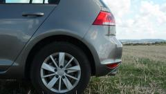 Back part of the car - car trunk - countryside field Stock Footage