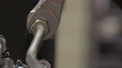 A wrench locking up the screw on the hose - stock footage
