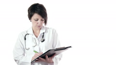 Brunette woman doctor standing and write medical chart, isolated Stock Footage