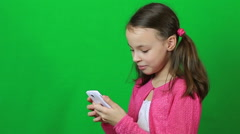 Stock Video Footage of Emotional little girl talking on Skype at phone