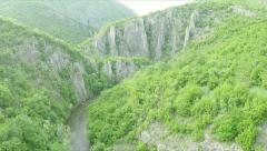 Flying over the river stream towards the cave. Stock Footage