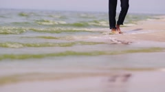 The man in trousers walks on water Stock Footage