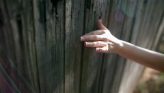 Hand girl climbing over the fence of the bride Stock Footage