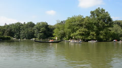 New York City Central Park Boat Lake Gondola Passing Tourist Attraction Daylight Stock Footage