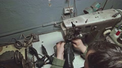 Shoemaker at work. Slow motion Stock Footage