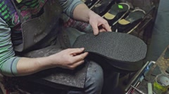 Shoemaker at work Stock Footage