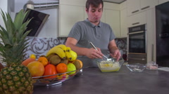 Whisking all the ingredients together in a big bowl Stock Footage
