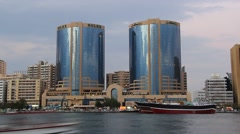 Dark slowly fall, Twin Tower building at Dubai Creek, time lapse shot. Stock Footage
