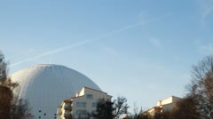 Pan tilt from sky to Stockholm Globe Arena - Ericsson Globe. Stock Footage