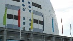 Close on flags and Stockholm Globe Arena - Ericsson Globe Stock Footage