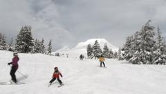 People Skiing Through Fresh Snow At Mountain Stock Footage
