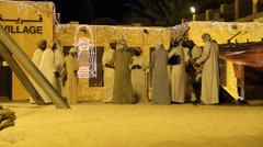 Group of Arab men sing and play traditional rhythmic music, heritage village Stock Footage