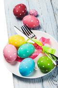 colored Easter eggs on wooden background - stock photo